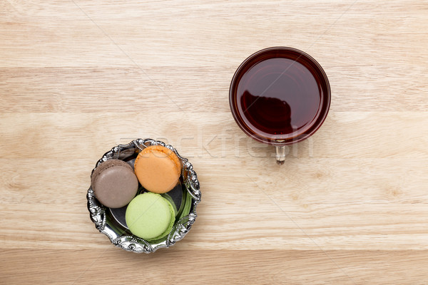 Verre tasse noir thé coloré macarons Photo stock © ironstealth