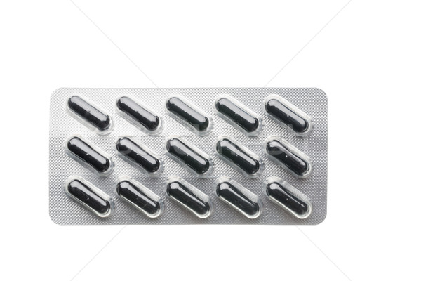 Black capsules in blister pack closeup isolated Stock photo © ironstealth