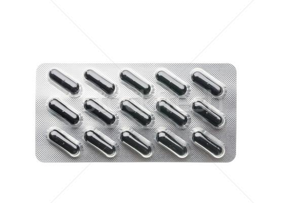 Fekete kapszulák hólyag csomag közelkép izolált Stock fotó © ironstealth