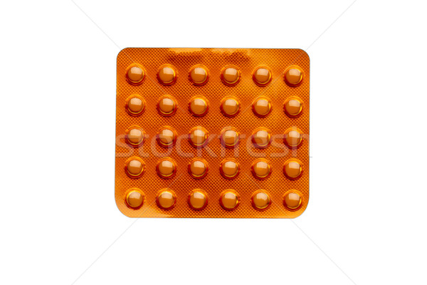 Orange pills in a blister pack isolated on white background Stock photo © ironstealth