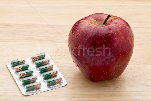 Green capsules bliter pack and fresh red apple  Stock photo © ironstealth