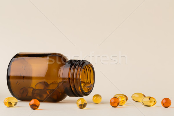 Fles pillen bruin glas visolie capsules Stockfoto © ironstealth