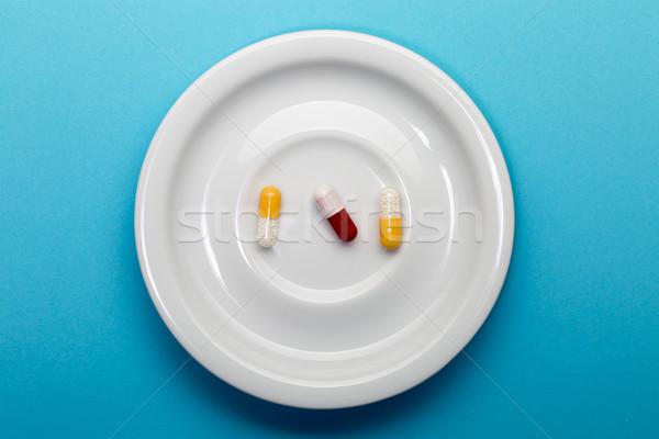 три красочный капсулы пластина синий здоровья Сток-фото © ironstealth