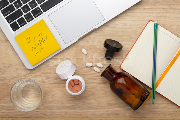 On-line treatment  anti stress concept with bottles of medicine pills on the table Stock photo © ironstealth