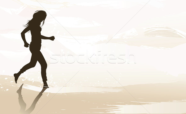 Woman jogging at the beach Stock photo © isaxar