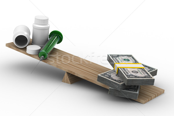 Medicine and money on scales. Isolated 3D image Stock photo © ISerg
