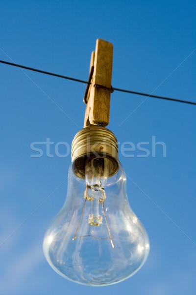 Bulbo enforcamento prendedor de roupa negócio vidro azul Foto stock © ISerg