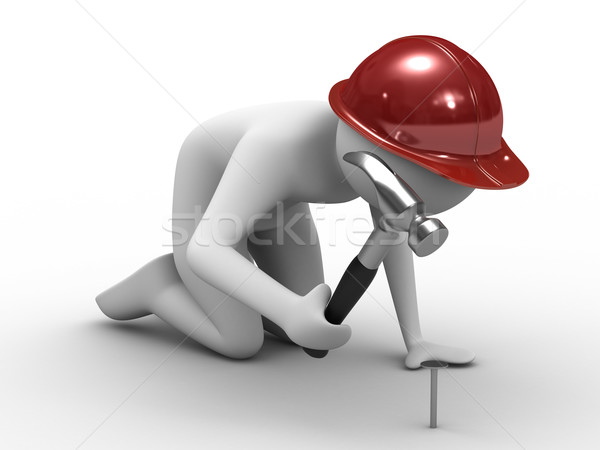 man hammer in nails. Isolated 3D image Stock photo © ISerg