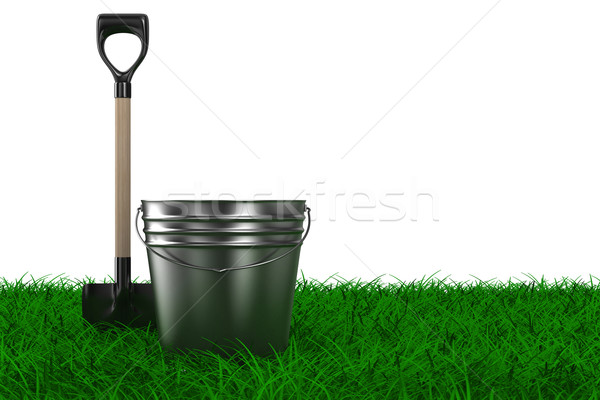 Shovel and bucket on grass. garden tool. Isolated 3D image Stock photo © ISerg