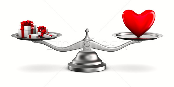 Heart and gift boxes on scales. Isolated 3D image Stock photo © ISerg