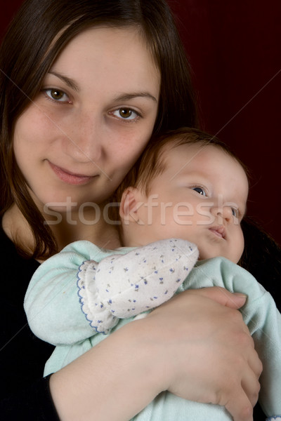 Young mum of the embracing favourite son Stock photo © ISerg