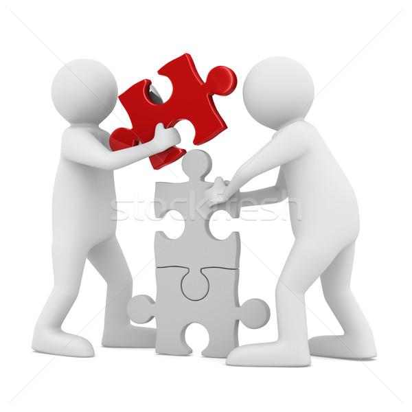 Dwa człowiek budować puzzle biały odizolowany Zdjęcia stock © ISerg