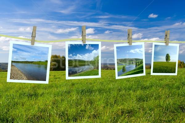 Landscape photographs hanging on a clothesline Stock photo © ISerg