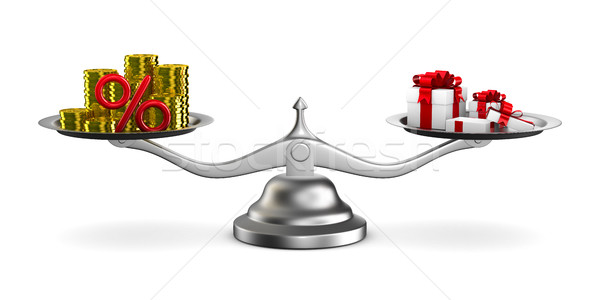 Gift box and cash on scale. Isolated 3D image Stock photo © ISerg