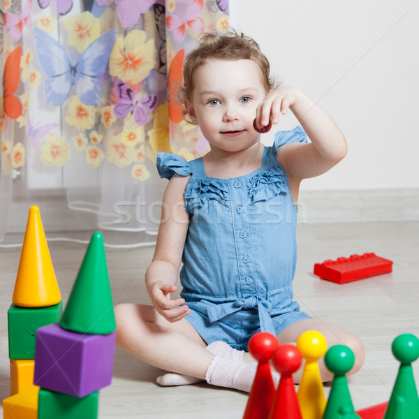 beautiful girl plays toys in room Stock photo © ISerg