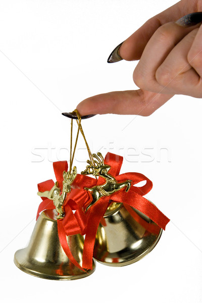 Two handbells hanging on a finger. White background. Stock photo © ISerg
