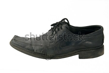 The old torn shoe on a white background Stock photo © ISerg