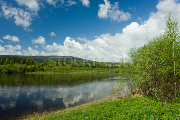 Summer landscape. Clouds above the river. Stock photo © ISerg