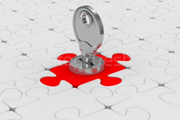 Puzzle with key on white background. Isolated 3D image Stock photo © ISerg
