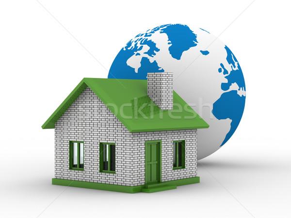 Small house and globe on  white background. Isolated 3D image Stock photo © ISerg
