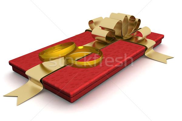 Gift box with wedding rings. 3D image. Stock photo © ISerg
