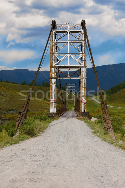 Old bridge through river Katun. Russia Siberia Stock photo © ISerg