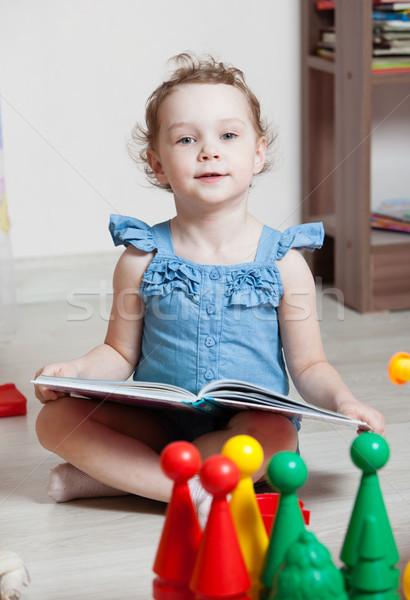 beautiful girl read book in room Stock photo © ISerg