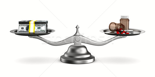 Medicines and money on scales. Isolated 3D image Stock photo © ISerg
