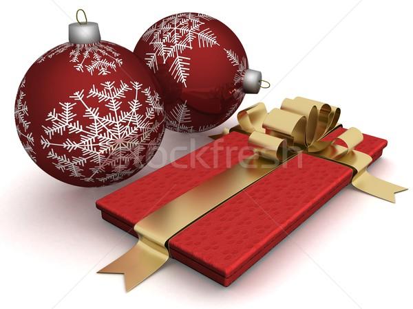 Gift box and christmas spheres. 3D image. Stock photo © ISerg