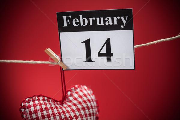14 día de san valentín rojo corazón calendario papel Foto stock © IvicaNS