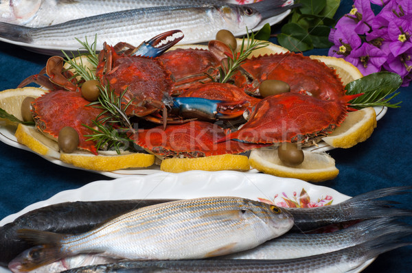 Dish with sea fishes and cooked crabs Stock photo © IvicaNS