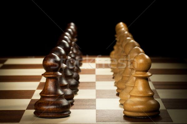 Houten schaken pion schaakstukken geïsoleerd zwarte Stockfoto © IvicaNS