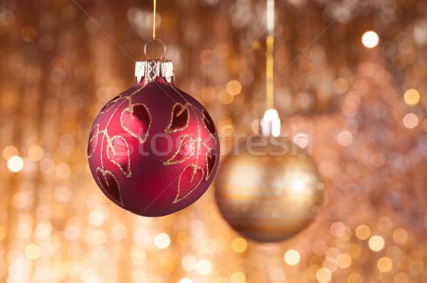 Vermelho ouro natal dourado luzes festa Foto stock © IvicaNS