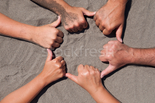 Stock photo: hands on sand
