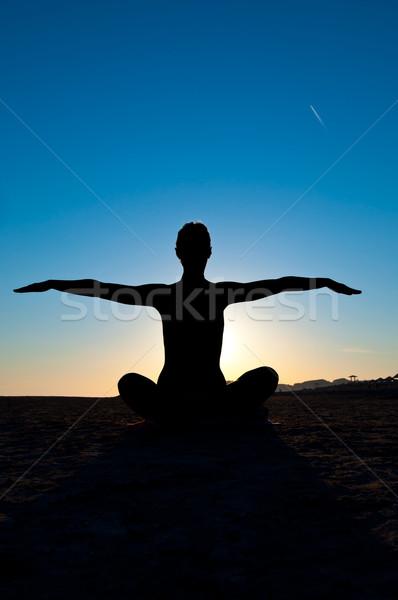 Kadın yoga pozisyon siluet meditasyon silah Stok fotoğraf © IvicaNS