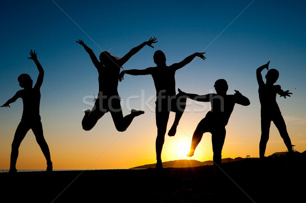 happy kids silhouettes jumping on the beach Stock photo © IvicaNS