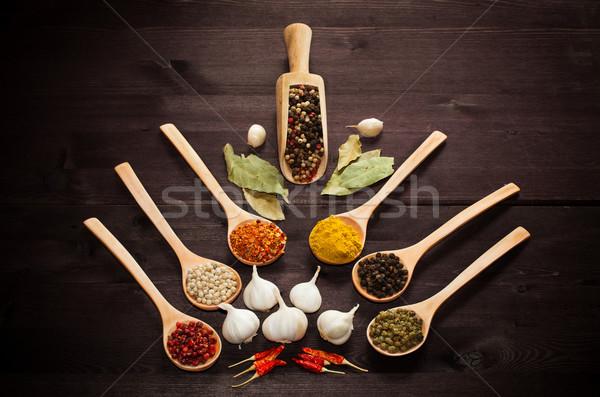 Különböző egzotikus fűszer kanalak fából készült tányér Stock fotó © IvicaNS