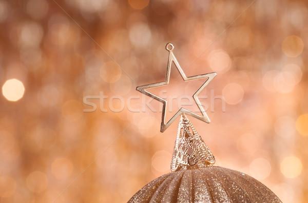 Ouro natal estrela topo dourado luzes Foto stock © IvicaNS