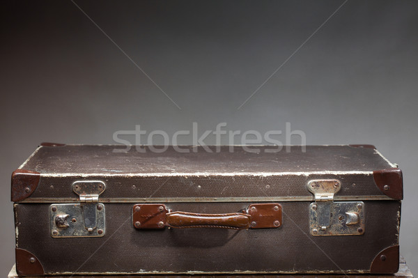 Old vintage suitcase on wooden table Stock photo © IvicaNS