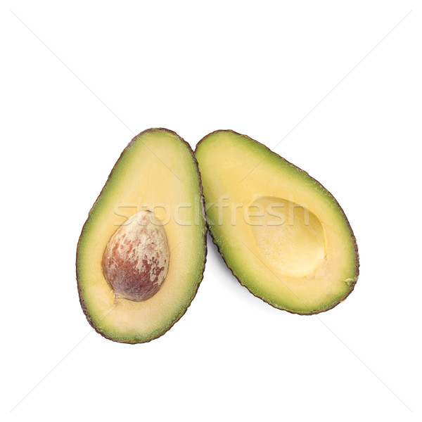 Two slices of avocado isolated on the white background. One slice with core. Stock photo © ivo_13