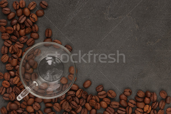 Stock photo: Cup of coffee on beans
