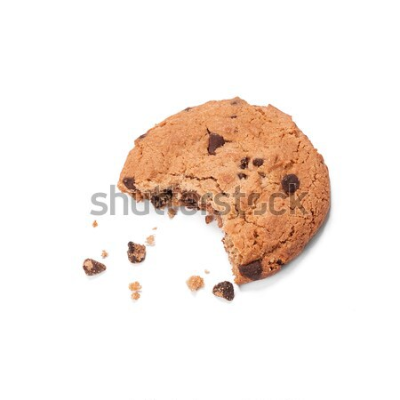 Single round chocolate chip biscuit with crumbs and bite missing, isolated on white from above. Stock photo © ivo_13
