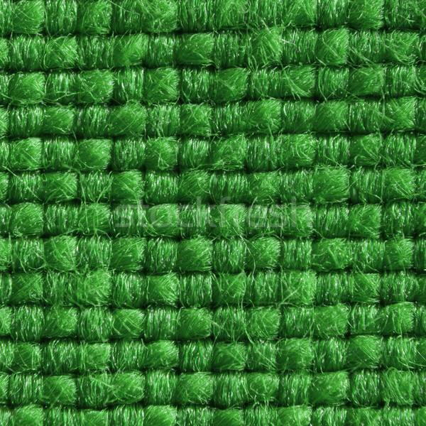 Green fabric with structured and knitted fibres extreme close up. 1:3 Stock photo © ivo_13