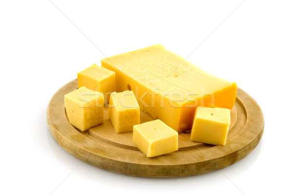Wooden plate with cheese Stock photo © ivonnewierink