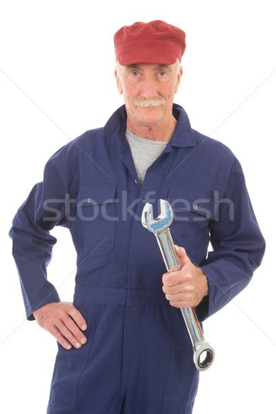 Férfi kék átfogó franciakulcs idős munka Stock fotó © ivonnewierink