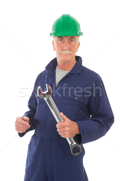 man in blue overall with green helmet and wrench Stock photo © ivonnewierink