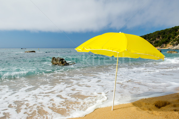 Yellow parasol at the beach Stock photo © ivonnewierink
