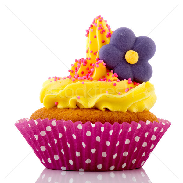 Pink cupcake with yellow cream and flower Stock photo © ivonnewierink