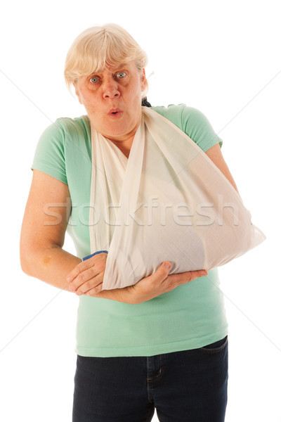 Old woman with broken wrist in gypsum Stock photo © ivonnewierink