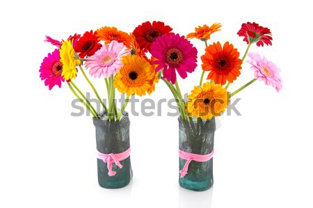 Glass vases with colorful Gerber flowers Stock photo © ivonnewierink